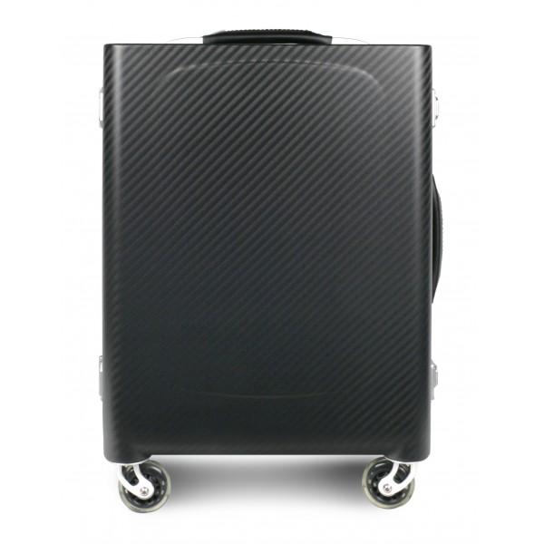TecknoMonster - Sinossi Small TecknoMonster - Valigia in Fibra di Carbonio Aeronautico