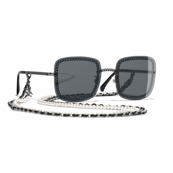 black square sunglasses with black chain attached